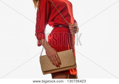 Young Woman In Red Dress With Clutch .