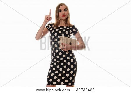 Surprised Girl In  Dress And Clutch Points To The Top