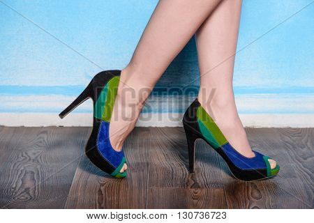 beautiful three-colored suede shoes on wood flour