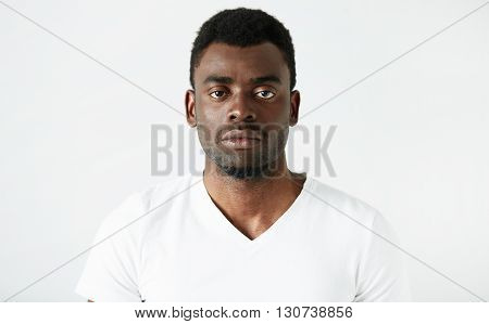 Isolated Headshot Of Handsome African American Adult Man In White T-shirt, Looking At The Camera Wit