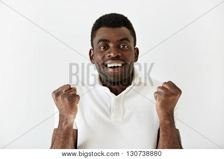 Headshot Of Happy Successful African American Student Or Businessman Looking With Winning Expression