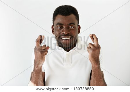 Close Up Shot Of African Man Crossing Fingers Wishing And Praying For Miracle, Hoping For The Best,