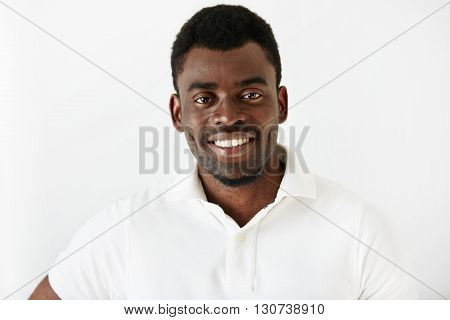 Close Up Portrait Of Attractive African American Office Worker Looking At The Camera With Happy And