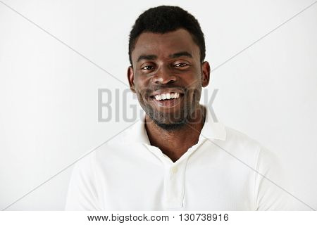 Close Up Portrait Of Handsome Successful Young Dark Skinned Male Entrepreneur In Casual Clothes, Loo
