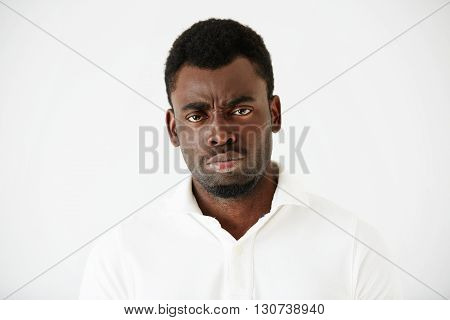 Close Up Shot Of Angry, Grumpy Or Pissed Off African American Man With Bad Mood, Looking And Frownin
