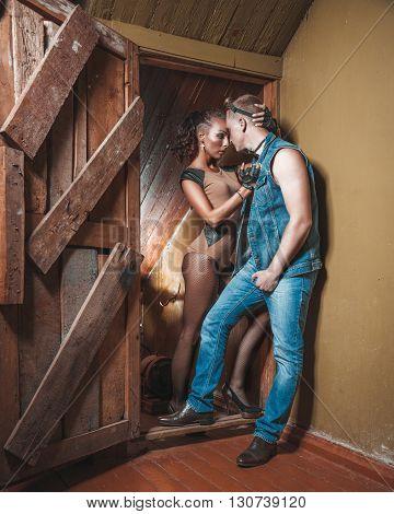 man and woman hug in the wooden door
