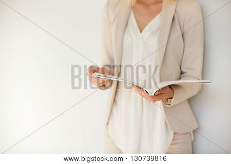 Student Girl Wearing White Shirt And Beige Suit Preparing For Final Exams At University. Attractive