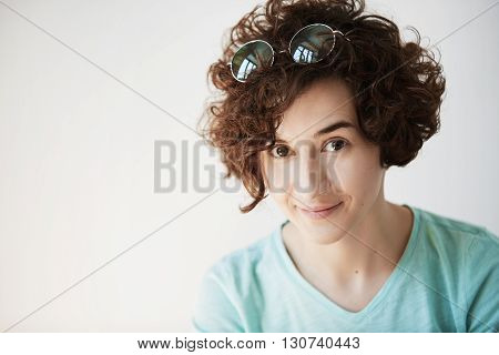 Human Face Expressions And Emotions. Portrait Of Female Freelancer With Dark Curly Hair And Brown Ey