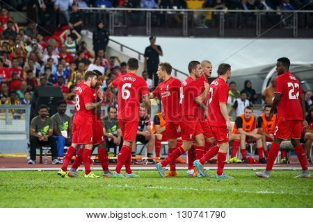 July 24, 2015- Shah Alam, Malaysia: Liverpool's players (red) celebrate a goal scored in a friendly match against the Malaysian Team. Liverpool Football Club from England is on an Asia tour.