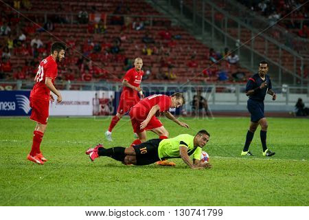 July 24, 2015- Shah Alam, Malaysia: Liverpool's Lucas Leiva (red) challenges for the ball against Charles Chad (10) in the friendly match against Malaysia. Liverpool from England is on an Asia tour.