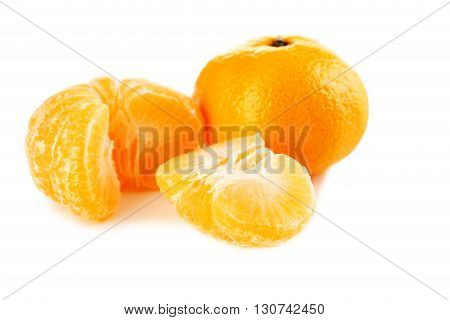 Ripe mandarins isolated on a white, close up
