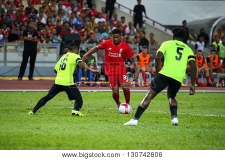 July 24, 2015- Shah Alam, Malaysia: Liverpool's Jordan Ibe (red) dribbles the ball in a friendly match against the Malaysian Team. Liverpool Football Club from England is on an Asia tour.