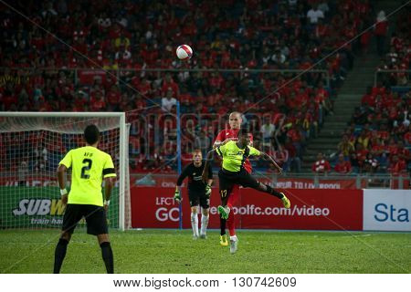 July 24, 2015- Shah Alam, Malaysia: Liverpool's Martin Skrtel (red) heads past Kumaahran (12) in a friendly match against the Malaysian Team. Liverpool Football Club from England is on an Asia tour.
