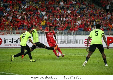 July 24, 2015- Shah Alam, Malaysia: Liverpool's Dovock Origi (red) dribbles the ball against Malaysian defenders in the friendly match. Liverpool Football Club from England is on an Asia tour.