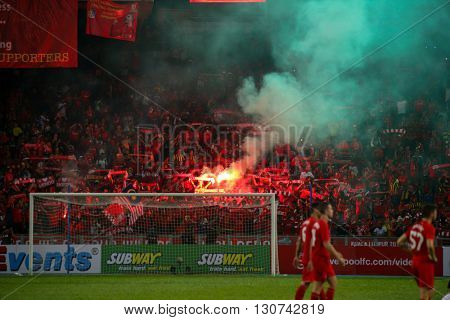 July 24, 2015- Shah Alam, Malaysia: Liverpool's fans let off red flares in the spectators gallery after the match between Liverpool FC and Malaysia. Liverpool FC from England is on an Asia tour.