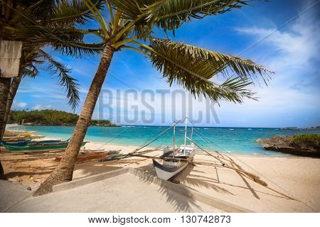 White boat on a tropical beach, Philippines traditional boat