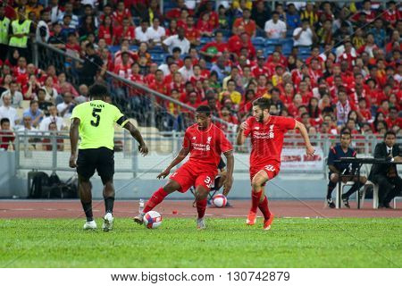 July 24, 2015- Shah Alam, Malaysia: Liverpool's Jordan Ibe (3) and Adam Lallana (20) plays in a friendly match against the Malaysian Team. Liverpool Football Club from England is on an Asia tour.
