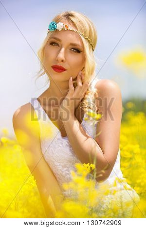 Sensual hippie woman in yellow flowers
