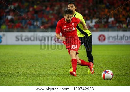July 24, 2015- Shah Alam, Malaysia: Liverpool's Adam Lallana (red) dribbles the ball in a friendly match against the Malaysian Team. Liverpool Football Club from England is on an Asia tour.