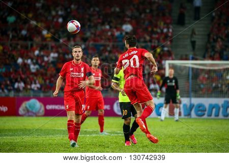 July 24, 2015- Shah Alam, Malaysia: Liverpool's Adam Lallana (20) and Jordan Henderson plays the ball in a friendly match against Malaysia. Liverpool Football Club from England is on an Asia tour.