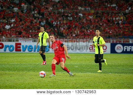 July 24, 2015- Shah Alam, Malaysia: Liverpool's captain Jordan Henderson (14) passes the ball in the friendly match against the Malaysian team. Liverpool Football Club from England is on an Asia tour.