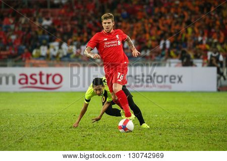 July 24, 2015- Shah Alam, Malaysia: Liverpool's Alberto Moreno (red) dribbles the ball in a friendly match against the Malaysian Team. Liverpool Football Club from England is on an Asia tour.