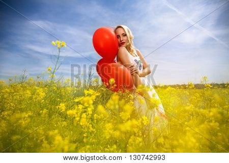 Sensual woman in yellow flowers enjoy in spring day