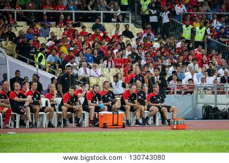 July 24, 2015- Shah Alam, Malaysia: Liverpool's players and officials watch the play from the team bench during the match against Malaysia. Liverpool Football Club from England is on an Asia tour.