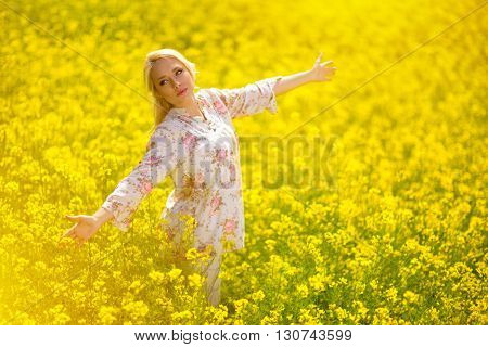 Young girl in meadow of yellow flower