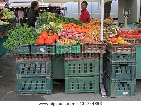 Man Is Selling Vegetables On The Street Market In Ljubljana, Slovenia