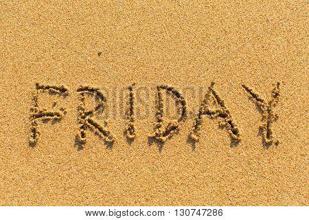 Friday - written by hand on a golden beach sand.