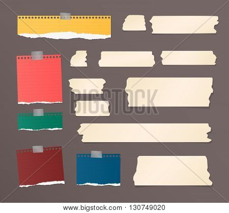 Pieces of ripped colorful blank note paper, brown sticky, adhesive tapes are stuck on dark wall.