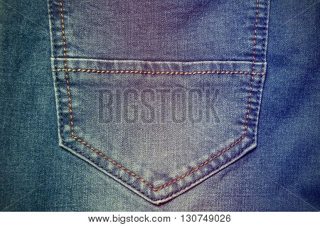 Fashion denim jeans pocket closeup. The pocket of old jeans