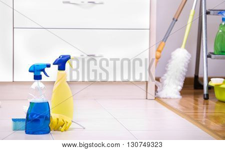 Two Spray Bottles On Kitchen Floor