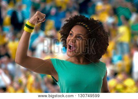 Brazilian woman fan celebrating in the stadium