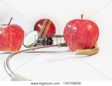 Health for game,two apples,a stethoscope and a deuce ball.