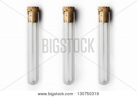 Three empty glass transparent test tube closed with cork on white background
