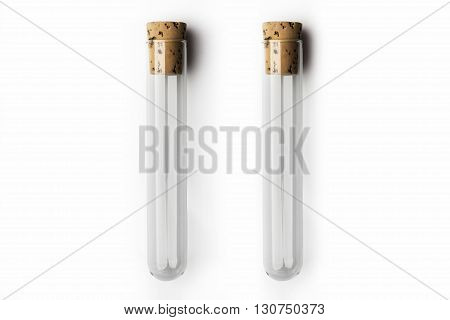 Two empty glass transparent test tube closed with cork on white background