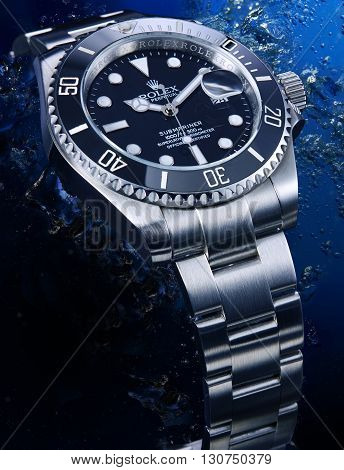 Bangkok, Thailand -  March 25, 2016: Luxurious wrist watch from Rolex for men on water background. Studio shot in Bangkok, Thailand.