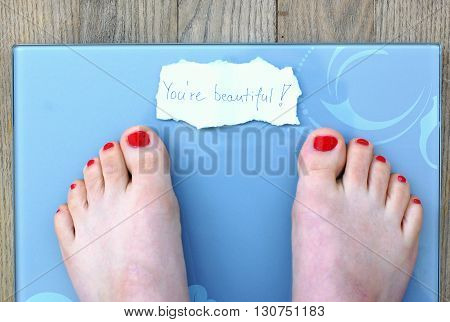 Feet On Scales With Message On The Wooden Background