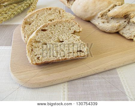 Homemade twisted baguette bread on cutting board