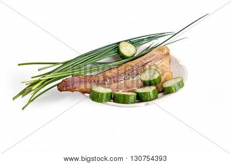 Plate with smoked fish onions and cucumber isolated on white background