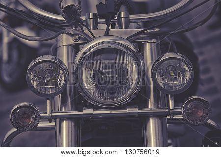 close up on classic front Motorcycle headlight