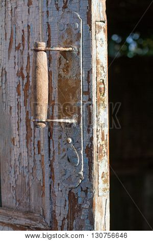 Rustic door knob on the old wooden door
