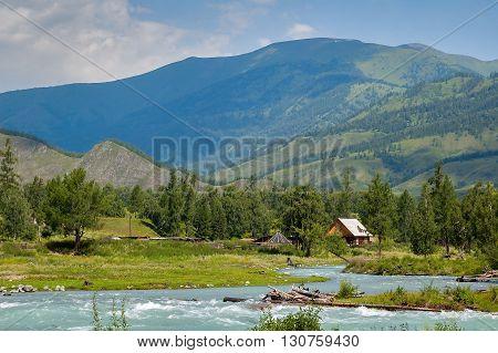 Altai, mountain river Kucherla, residential house in Kucherla village.  Russia