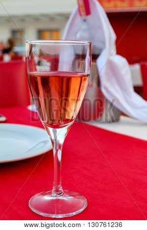 A glass of rose wine with a lip stain