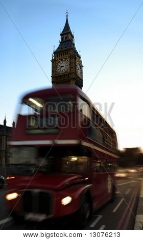 A classical view of London: the Big Ben and a red double decker bus.