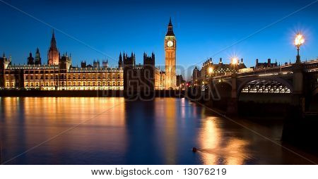 The famous landmarks of London: The Parliament, the Big Ben and the Thames by night.