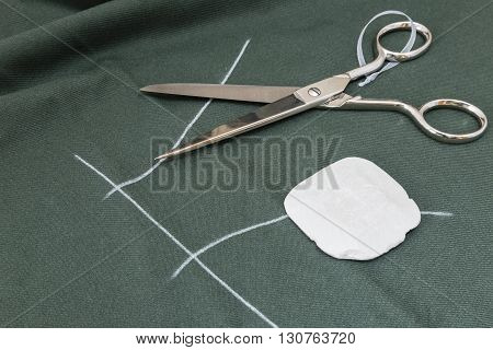Sewing tools and sewing kit on a green cloth
