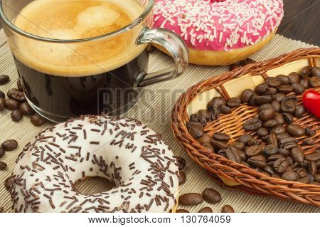 Fresh hot coffee and fresh donuts. Traditional sweets with coffee. Calorie junk food. Fresh unhealthy breakfast.